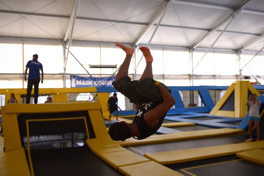 Parkour practicioner and full-time NSF Remus Koh does a flip on a trampoline at the main court at the newly opened Zoom Park on Dec 13, 2014. -- ST PHOTO: MARK CHEONG