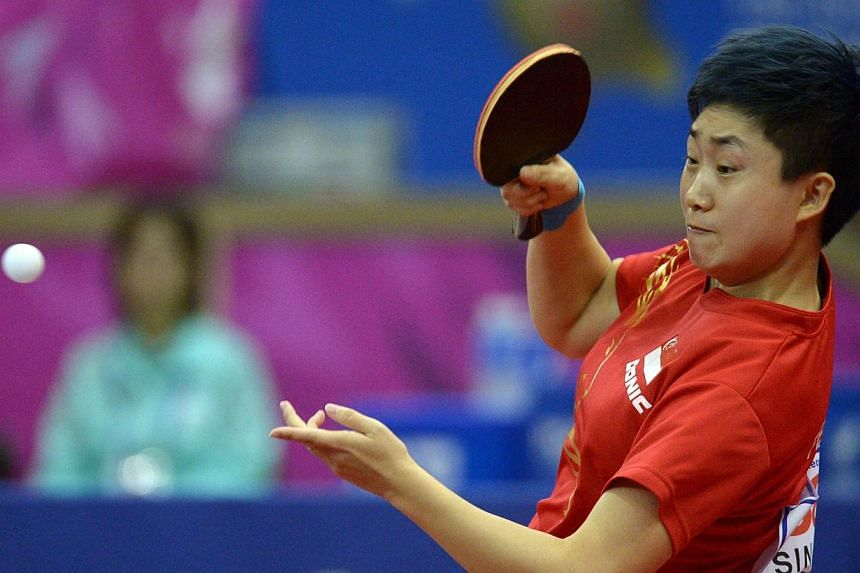 Singapore's top paddler Feng Tianwei crashed out of the International Table Tennis Federation World Tour Grand Finals, losing to South Korean Seo Hyo Won in the quarter-finals of the singles event on Saturday. -- ST PHOTO: DESMOND WEE
