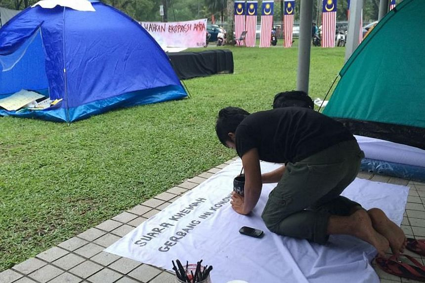 A group of students at Universiti Malaya's (UM) has started their own 'Occupy' camp-in protest against the university's punishment of eight undergraduates for organising an unauthorised talk featuring opposition leader Anwar Ibrahim. -- PHOTO: THE ST