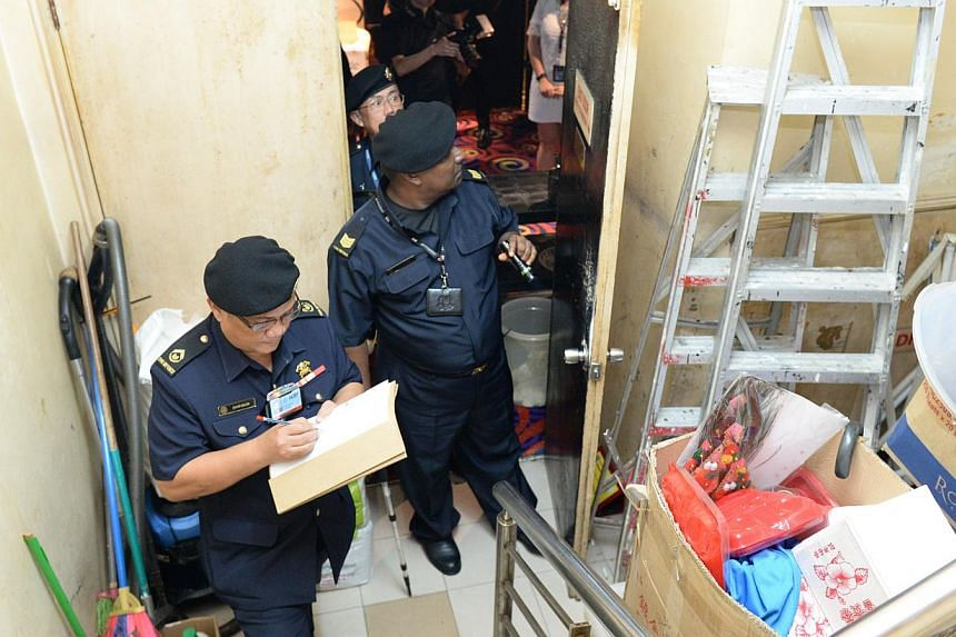 Officers from SCDF's Central Enforcement Department conducting fire safety checks on Dec 12, 2014. -- PHOTO: SCDF