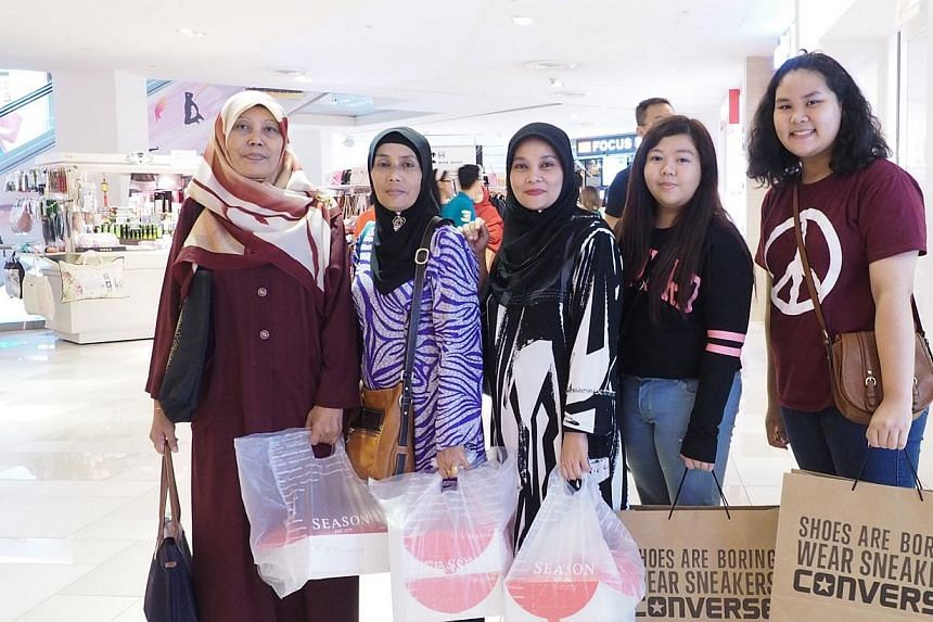 Singapore shopper Rostar Salim (left) and her sisters and nieces at Johor Bahru City Square. -- PHOTO: ERFENDI DHAHLAN