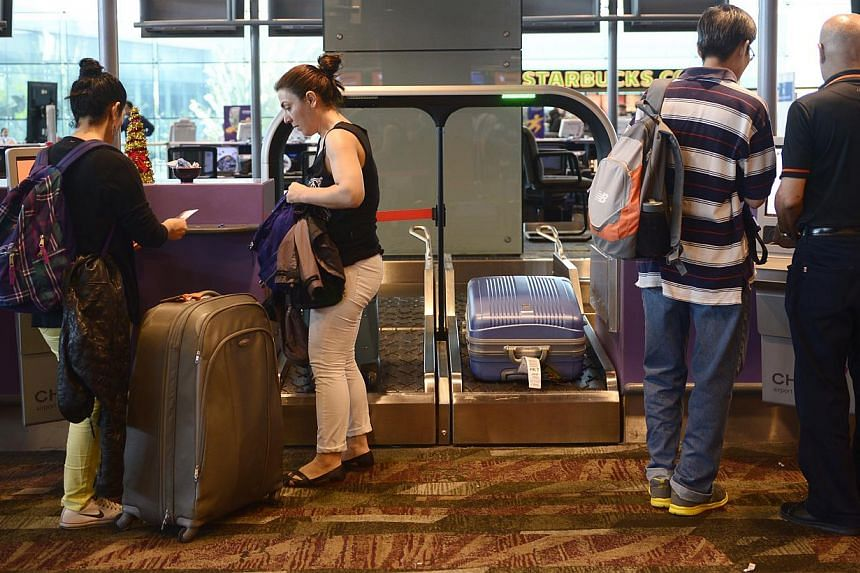 Between January and November, consumer watchdog Case acted on 92 complaints against carriers at Changi Airport. This is more than the 80 cases dealt with for the whole of last year and the 79 cases handled in 2012. -- ST PHOTO: MARK CHEONG