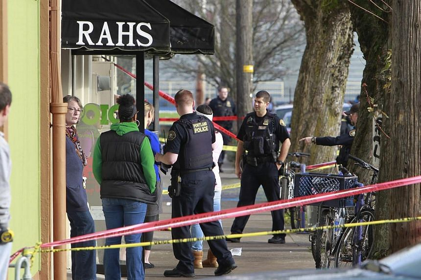 Police investigate outside the Rosemary Anderson High School in Portland, Oregon on Dec 12, 2014. -- PHOTO: REUTERS