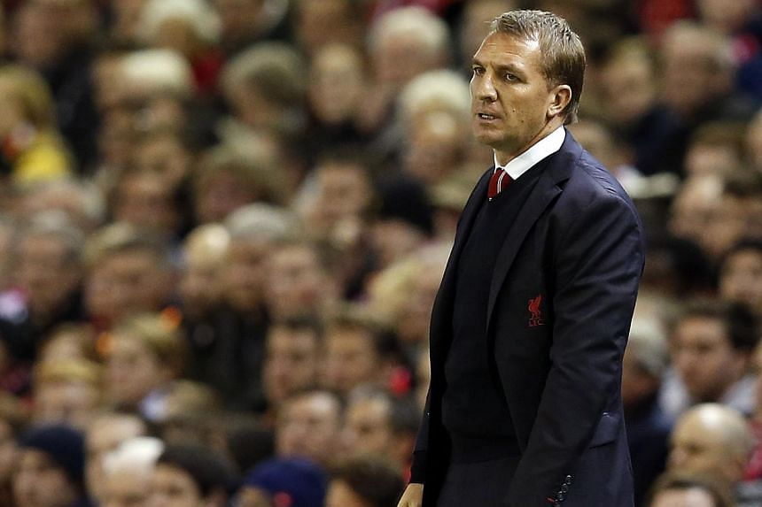 Brendan Rodgers (above) insists Liverpool can still compete with Manchester United in the transfer market despite their contrasting results in the last window. -- PHOTO: REUTERS