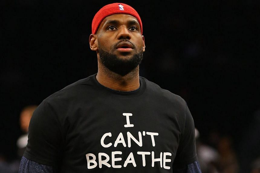 """Numerous players in both the NFL and NBA - including LeBron James (above) - have donned T-shirts reading """"I can't breathe,"""" the last words spoken by African American father-of-six Eric Garner who died after he was held in a chokehold by a New York po"""