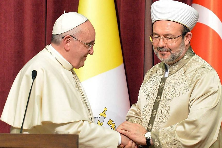 Turkey's top clericMehmet Gormez (right) meeting Pope Francis in Ankara, Turkey, on Nov 28, 2014. The Pope, who has made a point of eschewing luxury, opted to ride in a Renault Symbol during his visit to Turkey. -- PHOTO:AFP