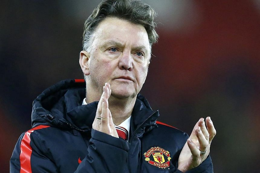 Manchester United record signing Angel Di Maria will miss the visit of bitter rivals Liverpool in the Premier League on Sunday, but the Old Trafford injury crisis is easing, manager Louis van Gaal (above) said on Friday. -- PHOTO: REUTERS