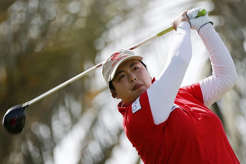 Feng Shanshan of China watches her shot from the 2nd tee during the final round of the Dubai Ladies Masters on Dec 13, 2014. -- PHOTO: REUTERS