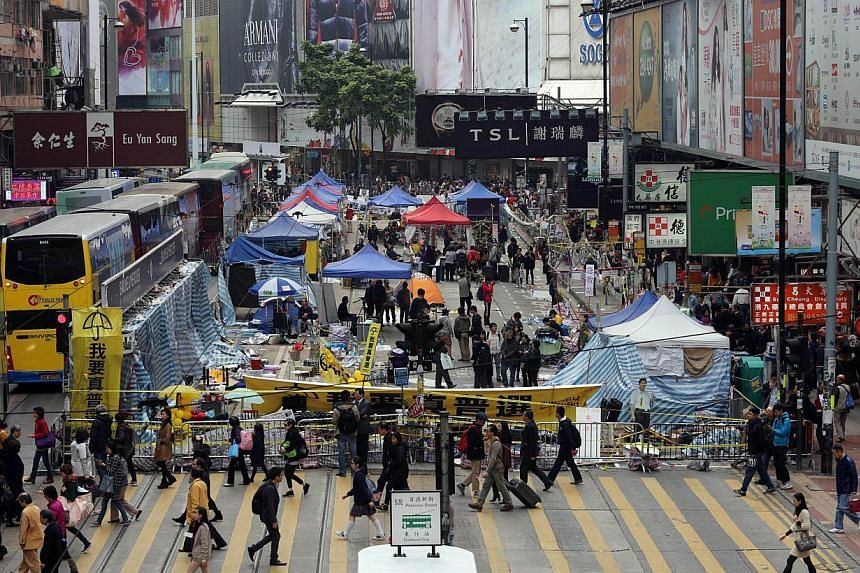 Hong Kong police said Saturday they will clear out the last pro-democracy protest site of Causeway Bay early next week, days after the main camp was dismantled with over 200 demonstrators arrested.-- PHOTO: AFP
