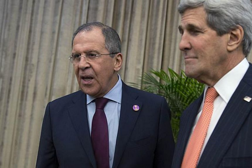 Russian Foreign Minister Sergei Lavrov (left) meeting US Secretary of State John Kerry at the Apec meeting in Beijing on Nov 8, 2014. Kerry and Lavrov will meet in Rome on Sunday, amid anger in Moscow over the prospect of new US sanctions and po