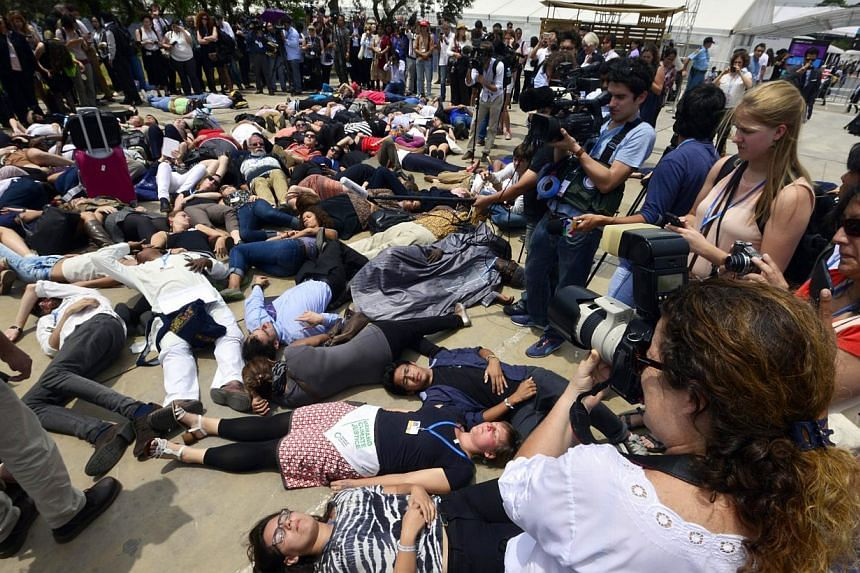 Acitivists from different organisations demonstrate on the side-lines of the UN COP20 and CMP10 climate change conferences being held in Lima on Dec 12, 2014. Talks on a pact to curb climate change entered their final day Friday, seeking an end to de