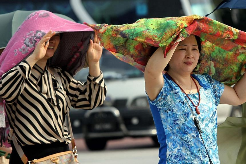 Tourists in Malaysia, like those above, may be required to have return tickets and sufficient funds.-- PHOTO: THE STAR/ASIA NEWS NETWORK