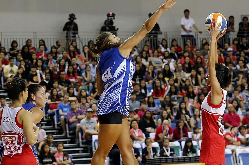 Singapore's Chen Huifen (right) in action against Samoa in the Netball Nations Cup final yesterday at the OCBC Arena. Samoa beat Singapore 50-41 to take the title. -- ST PHOTO:LAU FOOK KONG