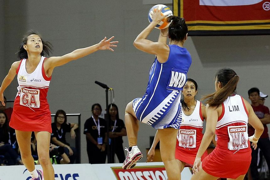 Singapore's Chen Huifen (left) in action against Samoa in the Netball Nations Cup final yesterday at the OCBC Arena. Samoa beat Singapore 50-41 to take the title. -- ST PHOTO:LAU FOOK KONG