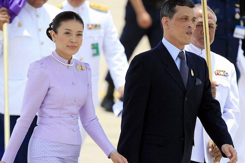 Thailand's Crown Prince Maha Vajiralongkorn walks with Royal Consort Princess Srirasmi after greeting foreign royalty in Bangkok in this June 11, 2006 file photo. Thailand's Princess Srirasmi, third wife of Crown Prince Vajiralongkorn, has resigned f
