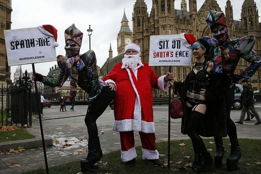 Protesters take part in a demonstration against new laws on pornography outside parliament in central London Dec 12, 2014. -- PHOTO: REUTERS