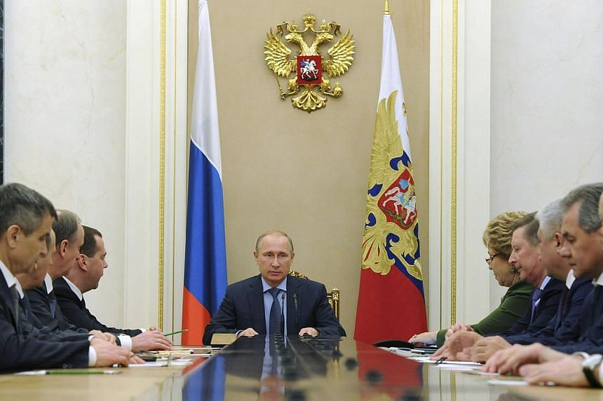 Russia's President Vladimir Putin (centre) chairs a meeting with permanent members of the Security Council at the Kremlin in Moscow, Dec 12, 2014. Russia's Foreign Ministry on Friday sternly criticised a Bill on Ukraine that passed the US Senate, s