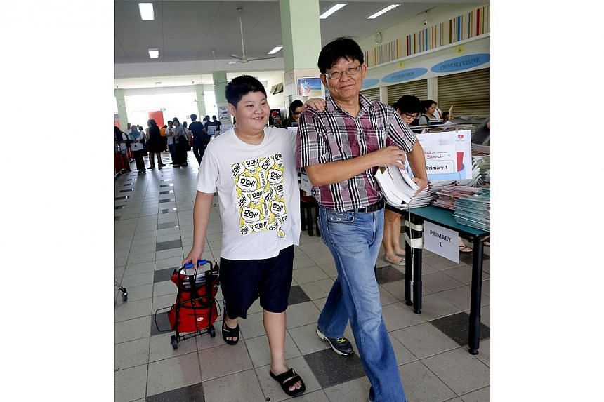 A record 400,000 textbooks, collected for the FairPrice Share-A-Textbook Project, were given out free to needy students on Dec 13. -- ST PHOTO: CHEW SENG KIM
