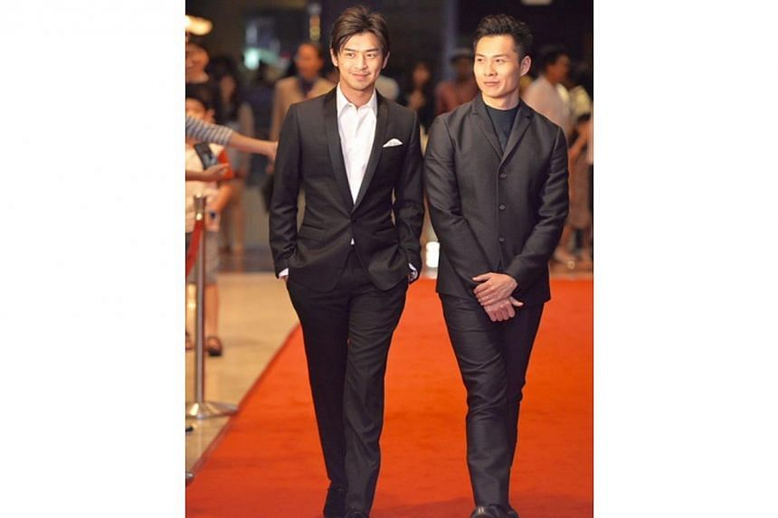 Actor Chen Bo Lin ( left ) and Singapore director Anthony Chen walking down the red carpet before the start of the awards ceremony at the Sands Theatre, Marina Bay Sands.-- ST PHOTO: DESMOND FOO