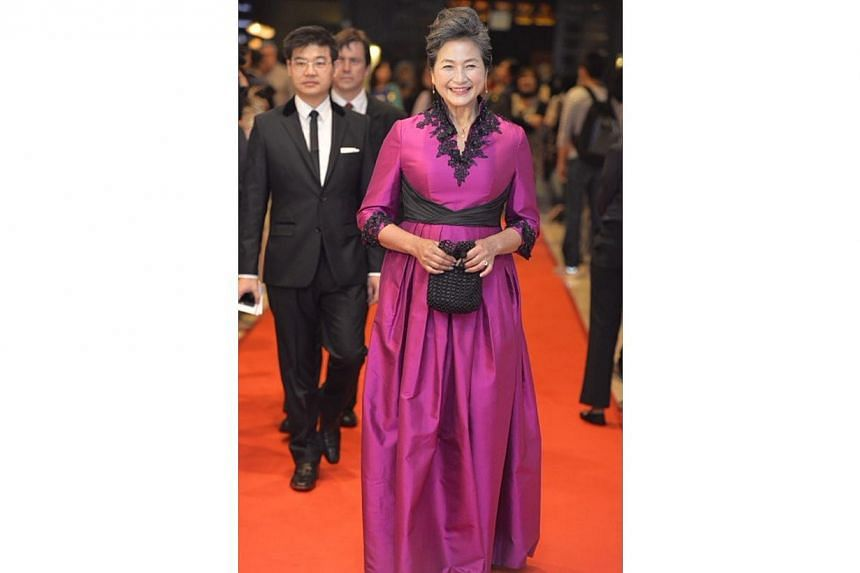 Veteran action star Cheng Pei Pei walking the red carpet before the start of the awards ceremony at the Sands Theatre, Marina Bay Sands.-- ST PHOTO: DESMOND FOO