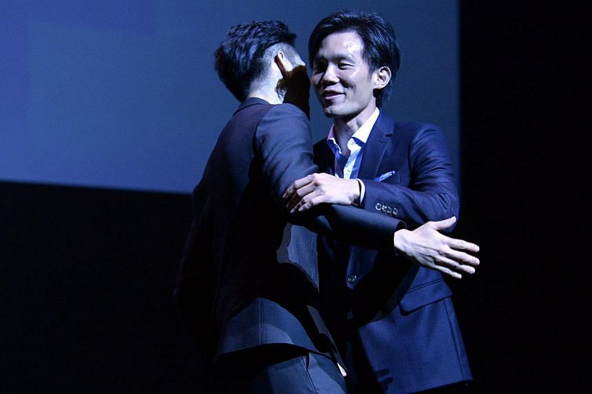 Singaporean film maker Tan Shijie receiving his award from director Anthony Chen atThe 25th Singapore International Film Festival (SGIFF) Silver Screen Awards.-- ST PHOTO: DESMOND FOO