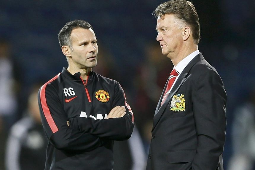 Manchester United manager Louis van Gaal (right) and assistant Ryan Giggs chat ahead of their team's English Premier League soccer match against West Bromwich Albion on Oct 20, 2014. Manchester United manager Louis van Gaal says he has sympathy for L