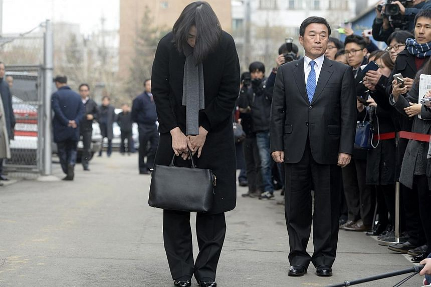 Cho Hyun-ah, also known as Heather Cho, daughter of chairman of Korean Air Lines, Cho Yang-ho, bows in front of the media outside the offices of the Aviation and Railway Accident Investigation Board of the Ministry of Land, Infrastructure, Transport,