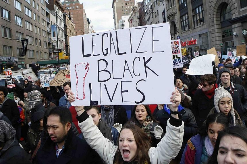 People march down 14th Street on Dec 13, 2014 in New York City. Thousands of protesters paralysed parts of New York and Washington on Saturday, stepping up demonstrations across the United States demanding justice for black men killed by white police