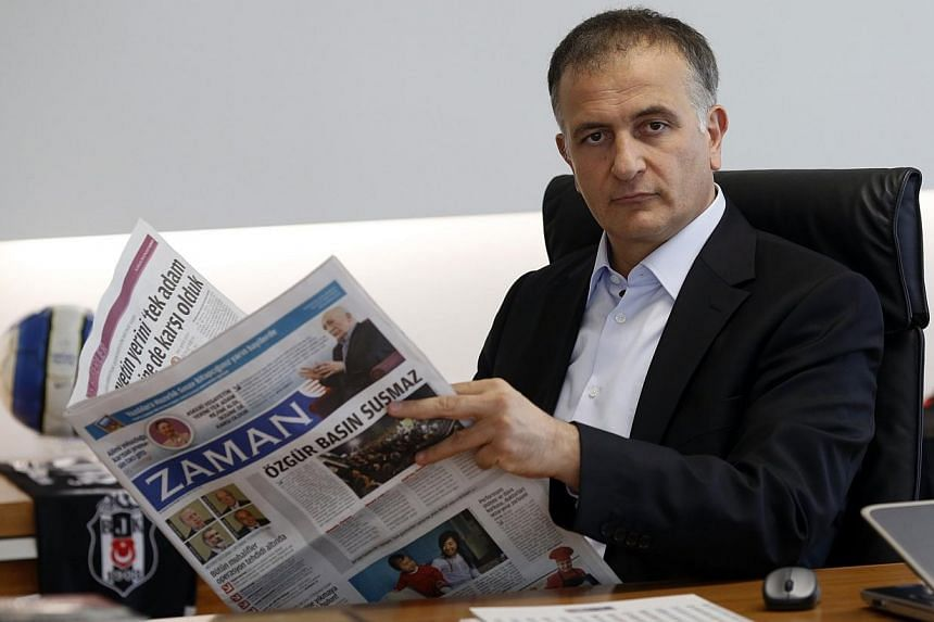 Zaman editor-in-chief Ekrem Dumanli holds a copy of his newspaper at the headquarters of Zaman daily newspaper in Istanbul on Sunday, Dec 14, 2014.Turkish police on Sunday detained the chief editor of a top newspaper as part of an ongoing opera