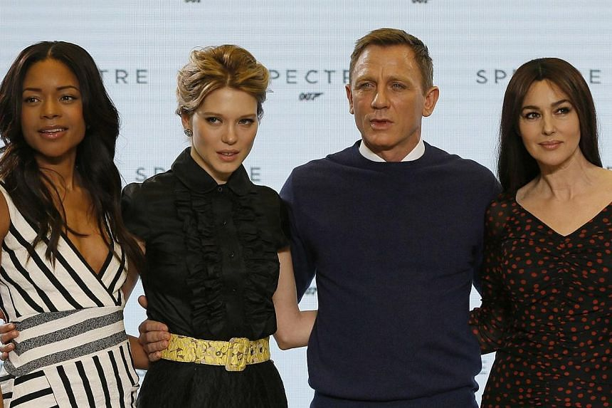 Naomie Harris, Lea Seydoux, Daniel Craig and Monica Bellucci (left to right) pose on stage during an event to mark the start of production for the new James Bond film Spectre, at Pinewood Studios in Iver Heath, southern England Dec 4, 2014. -- PHOTO: