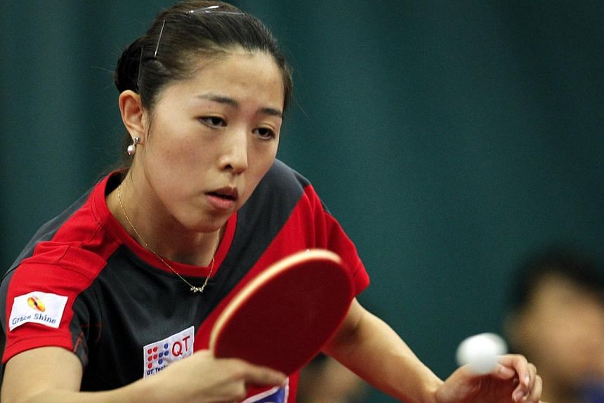 Singapore paddler Yu Mengyu's unexpected run in the International Table Tennis Federation (ITTF) World Tour Grand Finals came to an end today after she fell in the semi-finals. -- PHOTO: ST FILE