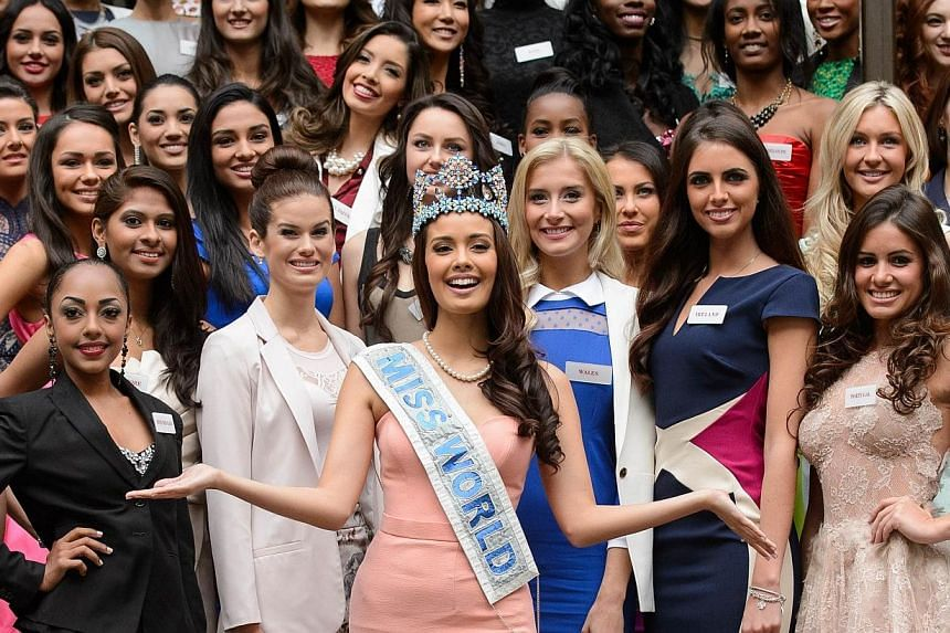 In a file picture taken on Nov 25, 2014, Miss World 2014 contestants, led by the current Miss World, Megan Young from the Philippines, pose for pictures at a photocall in central London. -- PHOTO: AFP