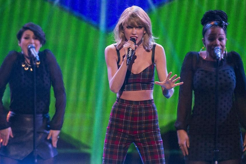 Singer Taylor Swift performs at Z100's Jingle Ball 2014 at Madison Square Garden in New York on Dec 12, 2014. -- PHOTO: REUTERS