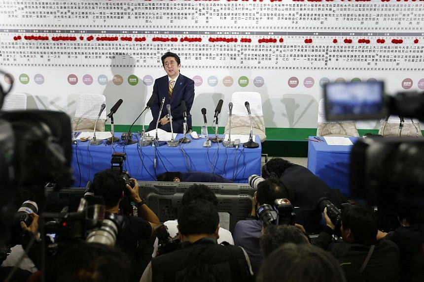 Japan's Prime Minister Shinzo Abe, who is also leader of the ruling Liberal Democratic Party (LDP), speaks during a news conference at the LDP headquarters in Tokyo on Dec 14, 2014. -- PHOTO: REUTERS