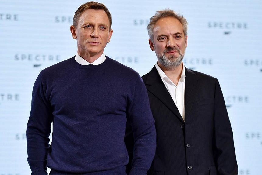 British director Sam Mendes (right) and actor Daniel Craig (left) pose during an event to launch the 24th James Bond film Spectre at Pinewood Studios at Iver Heath in Buckinghamshire, west of London, on Dec 4, 2014. -- PHOTO: AFP