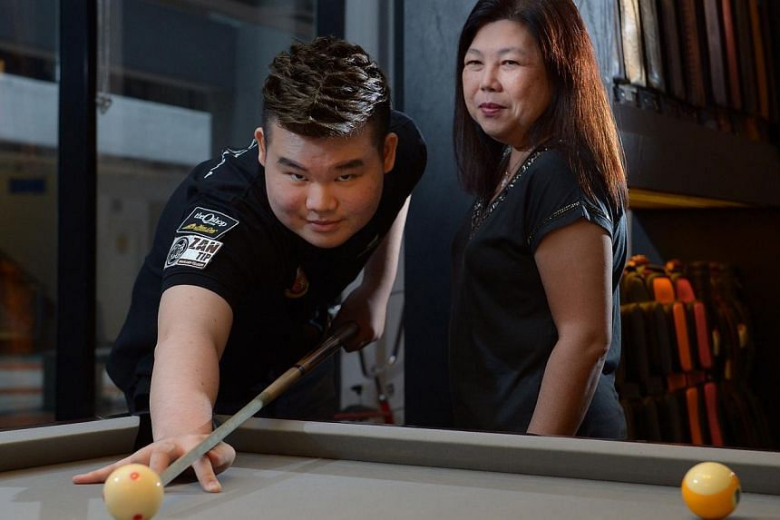 Aloysius Yapp, with his mum Angie Tay, is eyeing a chance to win a gold medal before a home crowd in next year's SEA Games.