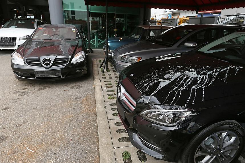 Seven Luxury Cars Splashed With Paint Remover At Car Workshop In