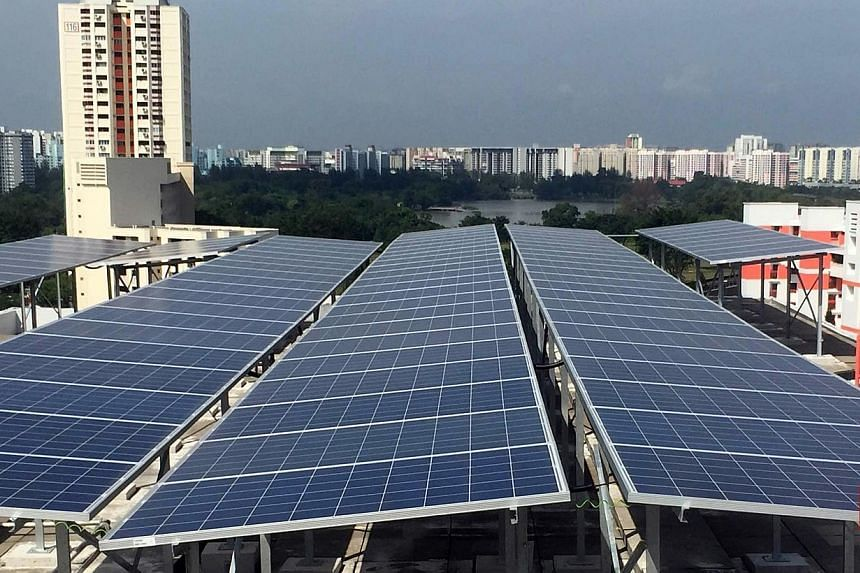 Solar panels recently installed on the rooftop of an HDB block at Jurong East St 21.Some 680 Housing Board blocks in four residential towns - Jurong East, Marine Parade, Sembawang and Tampines - are to have solar panels installed. -- PHOTO:&nbs