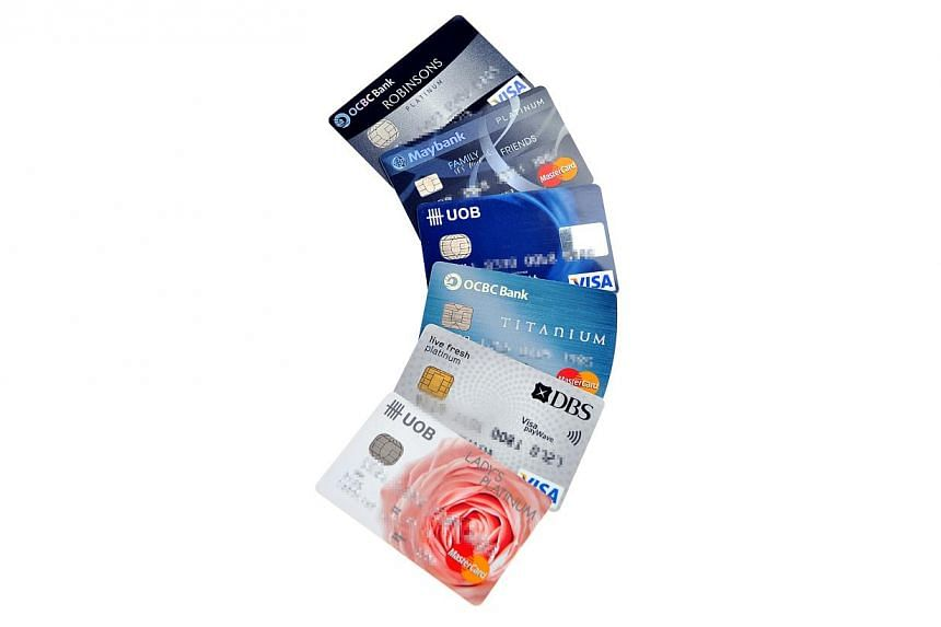 Paying with plastic has become so common that outstanding credit card loans are set to top $10 billion for the first time by Christmas. -- PHOTO: ST FILE