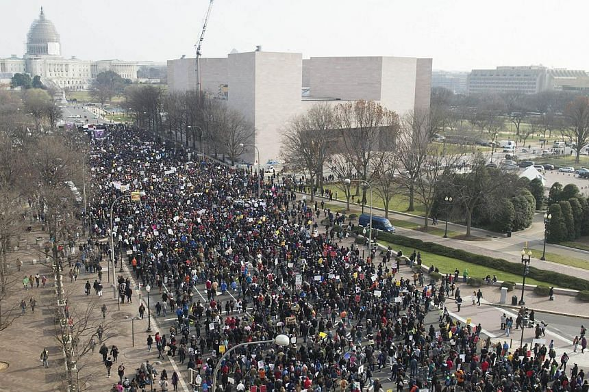 Thousands take part in the Justice for All March and Rally down Pennsylvania Avenue to the US Capitol in Washington, DC, on Dec 13, 2014. Thousands of people descended on Washington to demand justice Saturday for black men who have died at the hands