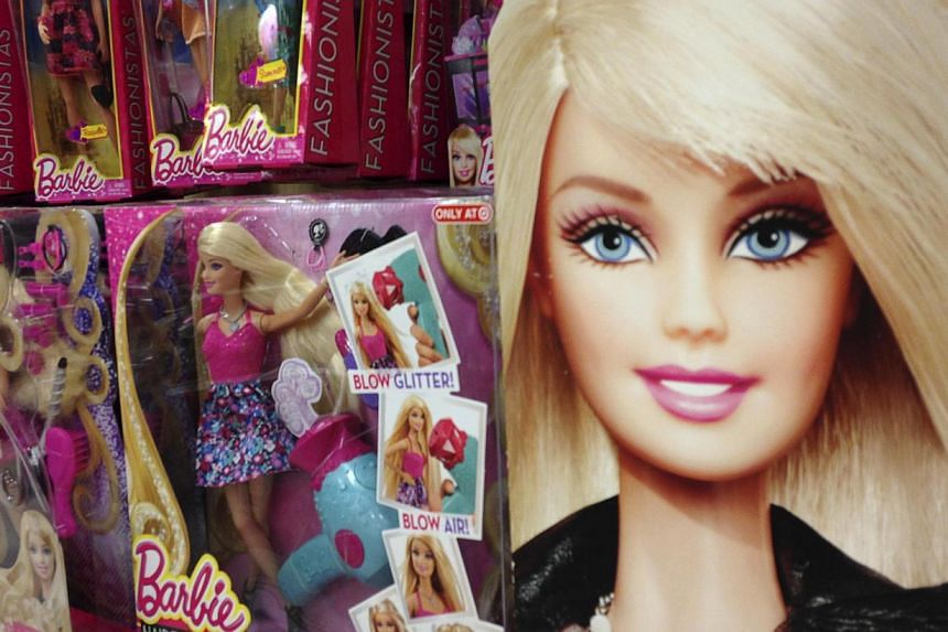 Barbie dolls are shown in the toy department of a retail store in Encinitas, California Oct 14, 2014.  A group of feminists, some dressed as princesses and maids, briefly occupied a Paris toy shop on Saturday to protest the gender stereotypes fu