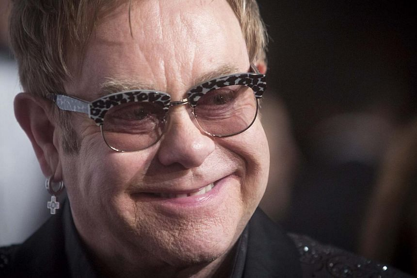 """Pop music great Elton John (above) opened a new stand named after him at English Championship club Watford's Vicarage Road ground on Saturday, describing it as """"one of the greatest days of my life"""". -- PHOTO: REUTERS"""