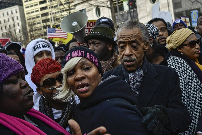 Reverend Al Sharpton marches with family members of Eric Garner, Michael Brown, Tamir Rice and Trayvon Martin to Capitol Hill in a protest against police violence organised by the National Action Network in Washington Dec 13, 2014. -- PHOTO: REUTERS