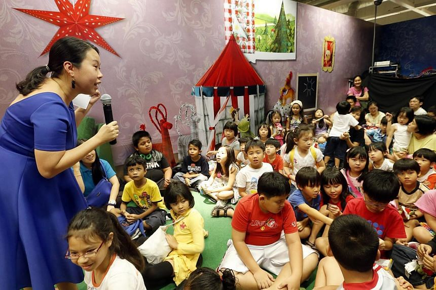 Former ST journalist Clara Chow role-playing with Ikea toys and telling stories to children at Ikea Tampines. -- ST PHOTO: CHEW SENG KIM