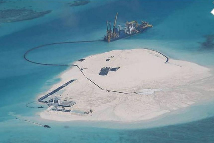 A photograph dated Feb 25, 2014, of the Johnson South Reef, which is claimed by the Philippines and Vietnam and whichappear to show large-scale reclamation in stages done by China.Vietnam has helped ensure peace in the South China Sea dis