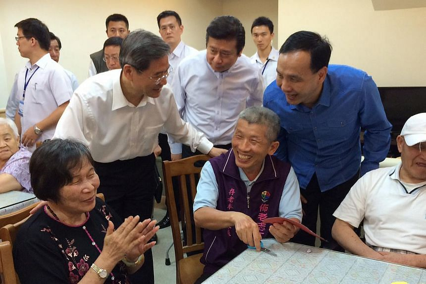 New Taipei City Mayor Eric Chu (in blue) visiting an elder-care home with Mr Zhang Zhijun (second from left), director of China's Taiwan Affairs Office, in Taiwan in June 2014. Taiwan's ruling Kuomintang party, reeling from its worst-ever