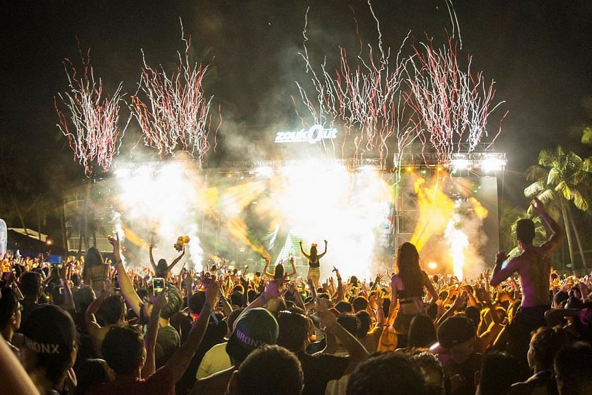 The crowd on Friday night at ZoukOut, with confetti blasts and paper streamers and pyrotechics that added to the top-notch production of the event.-- PHOTO:ZOUK MANAGEMENT