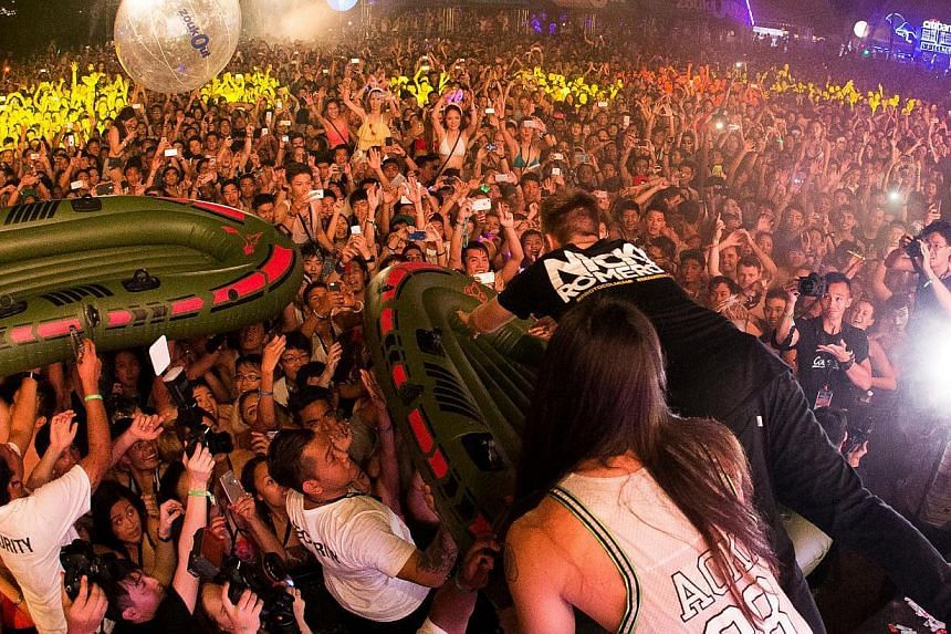 Dutch DJ Nicky Romero crowd surfs on an inflatable raft on Friday night at ZoukOut. -- PHOTO:ZOUK MANAGEMENT