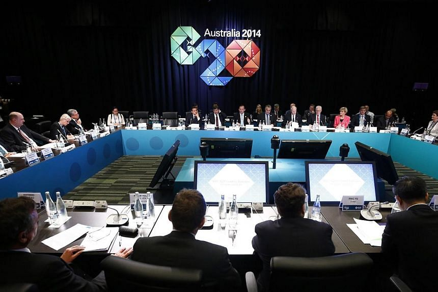 Australia's Prime Minister Tony Abbott (centre-in background) addresses the B20 meeting before the G20 leaders summit in Brisbane on Nov 14, 2014. In November this year, leaders of the Group of Twenty (G20) vowed to implement an anti-corruption