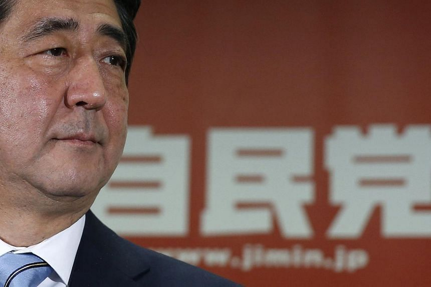 Japan's Prime Minister and the leader of the ruling Liberal Democratic Party (LDP), Shinzo Abe, attends a news conference following a victory in the lower house elections by his ruling coalition, at the LDP headquarters in Tokyo on Dec 15, 2014. -- P